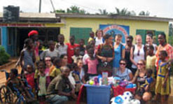 Nursing students make a donation at an orphanage in Ghana during a trip in January 2010.