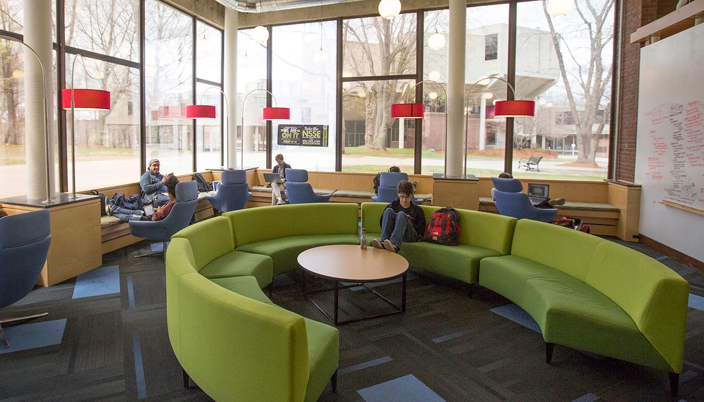 Students hanging out in O'Leary Library's lounge space.