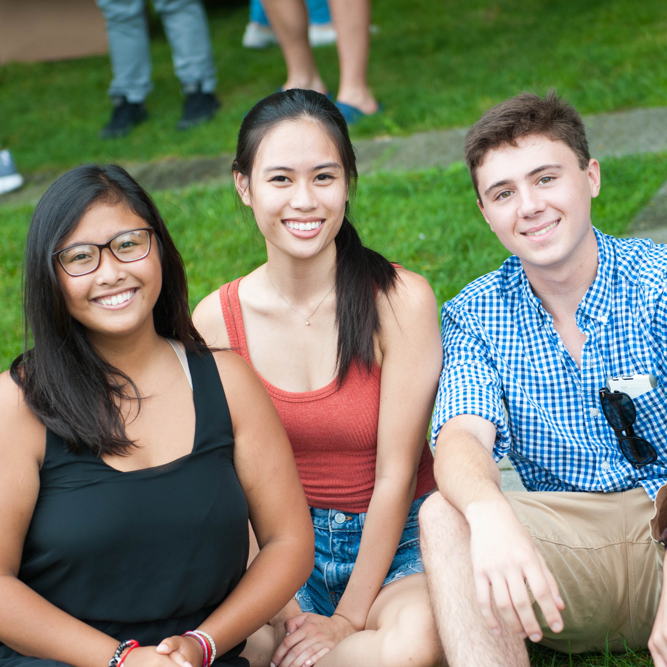 3 students smiling