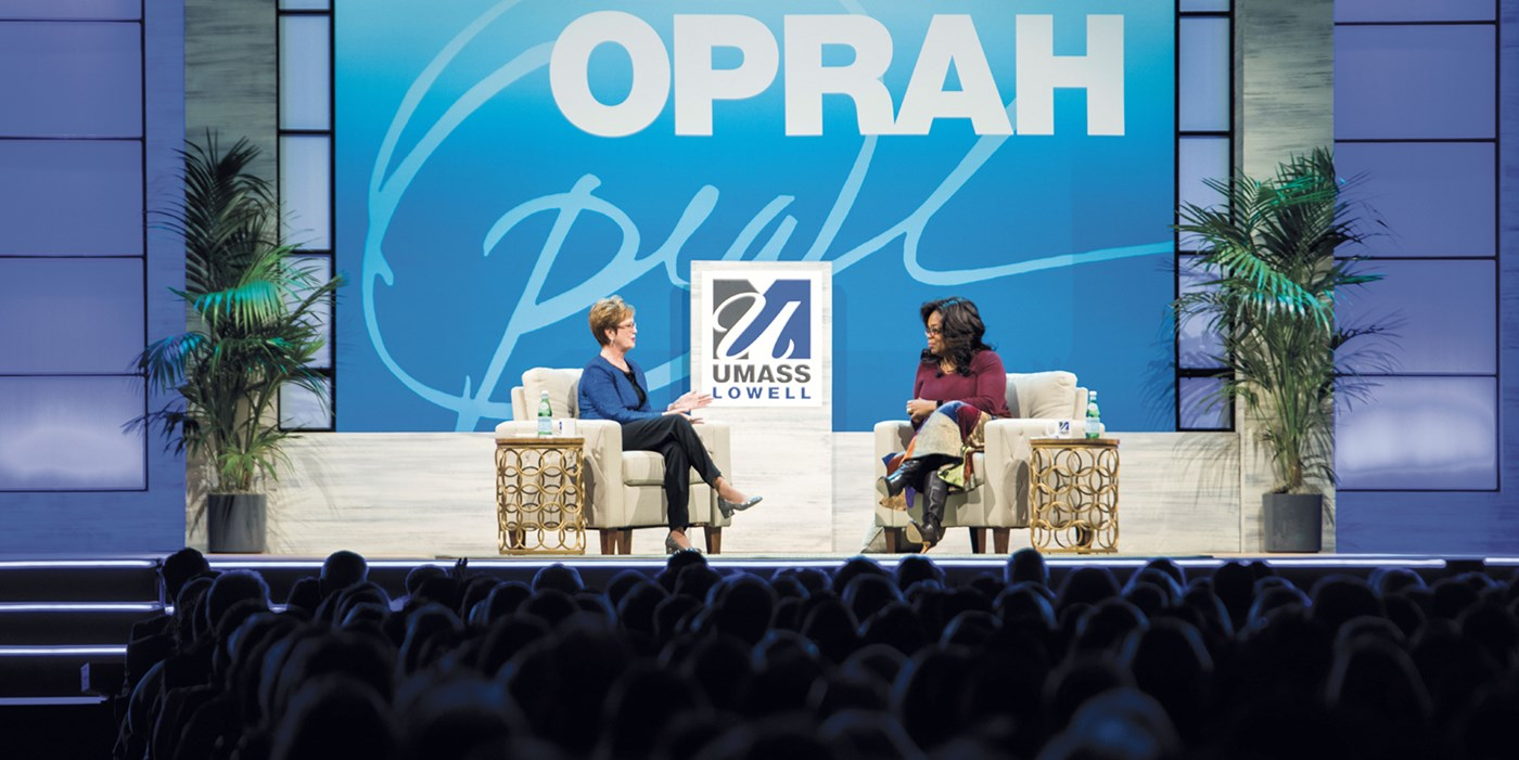 Oprah Winfrey onstage with Chancellor Jacquie Moloney at the Tsongas Center