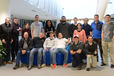 Ben Patton poses with UMass Lowell veterans that came out for the workshop.