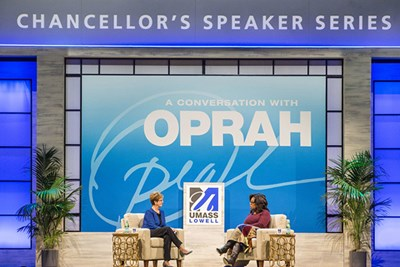 UMass Lowell Chancellor Jacquie Moloney and Oprah Winfrey on stage at the Chancellor's Speaker Series