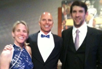 UMass Lowell Legal Studies Prof. Michael E. Jones and his wife, Christine, visited with Olympic swimmer Michael Phelps for an event in Baltimore in May.