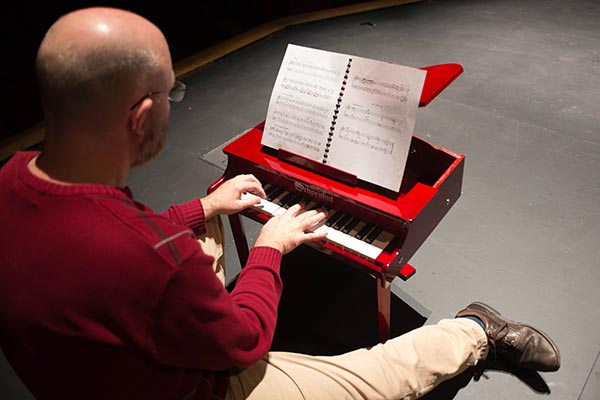 Aaron Rosenberg plays his toy piano
