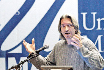 Human-rights activist John Prendergast speaks at UML s Day without Violence yesterday.