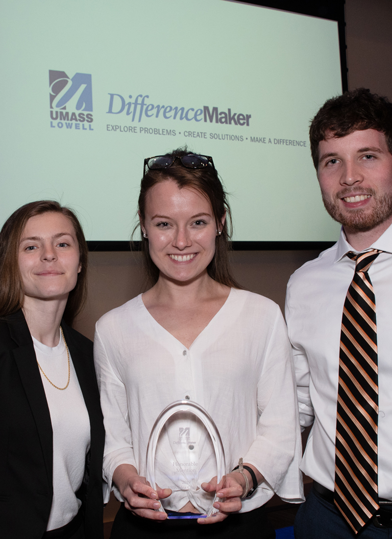 Tatiana Tompkins, Conrad Nelson and Jenna Olander hold their Honorable Mention award for Protected Pin at DifferenceMaker