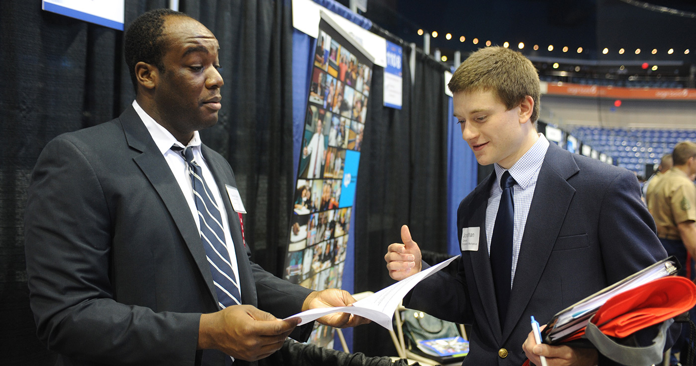 David Chieh III - Verizon corporate recruiter looks over Jonathan Campelli's resume at the Career Fair at the Tsongas Center.