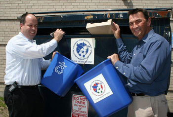 Director of environmental and emergency management Richard Lemoine, right, says increased recycling on campus reduces solid waste disposal costs. (Administrative services director Thomas Miliano is pictured at left).