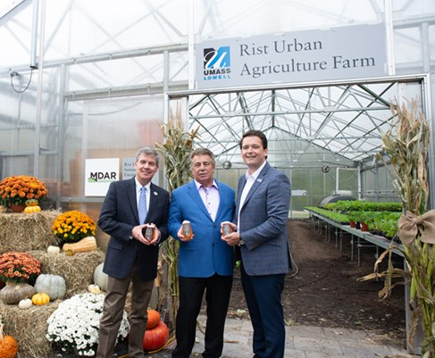 Brian Rist and Director of Sustainability Ruairi O'Mahoney stand in front of the Rist Urban Agriculture Greenhouse