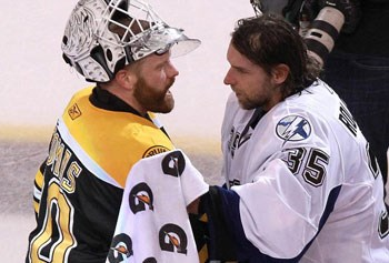 Tim Thomas and Dwayne Roloson/Globe file photo