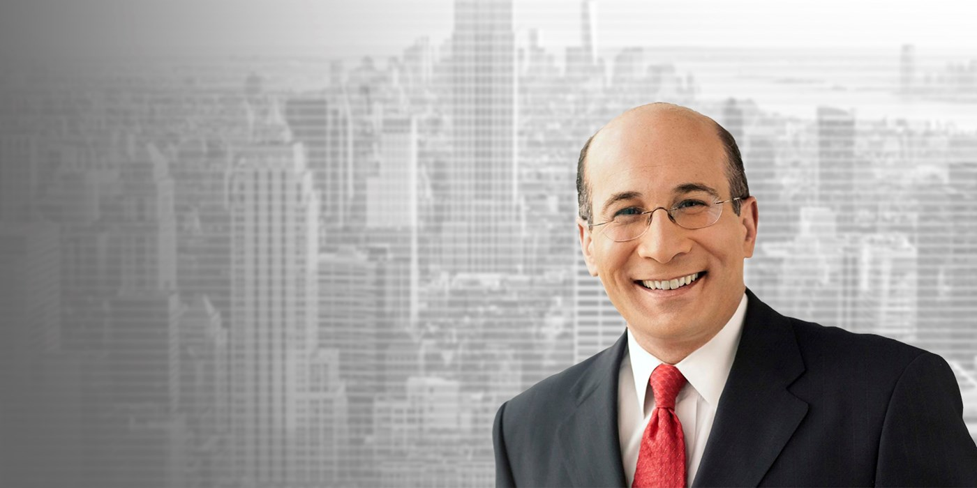 Headshot of Ron Insana, senior business analyst and commentator on CNBC, on gray cityscape background