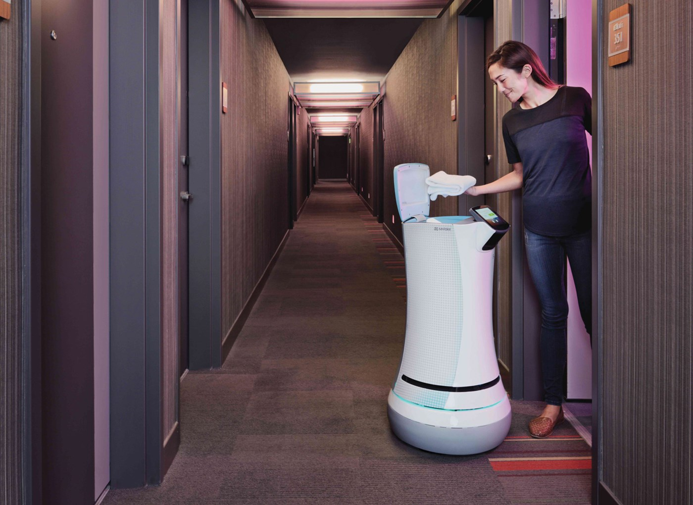 Robot brings room service at a hotel