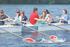 Instructor Dave Cormier of UMass Lowell conducts crew classes from his seat in the boat in a local program centered at the UML Bellegarde Boathouse. Lowell Sun photo by Bob Whtaker
