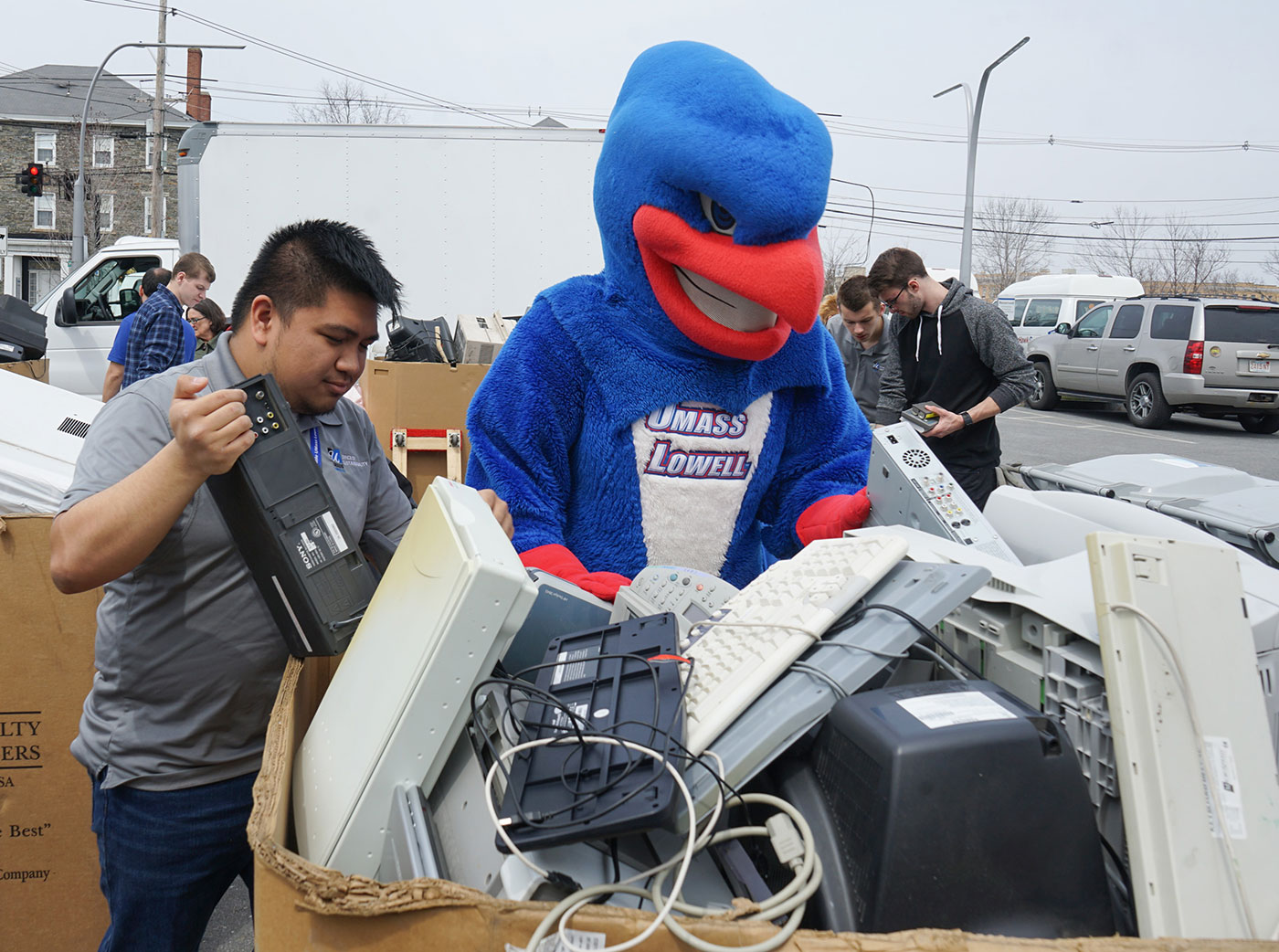 Rowdy the River Hawk assists with electronic recycling at UMass Lowell. Free, secure, recycling events for UMass Lowell Community Members are offered in the fall and spring each year by the Office of Sustainability and the IT Information Security Department.