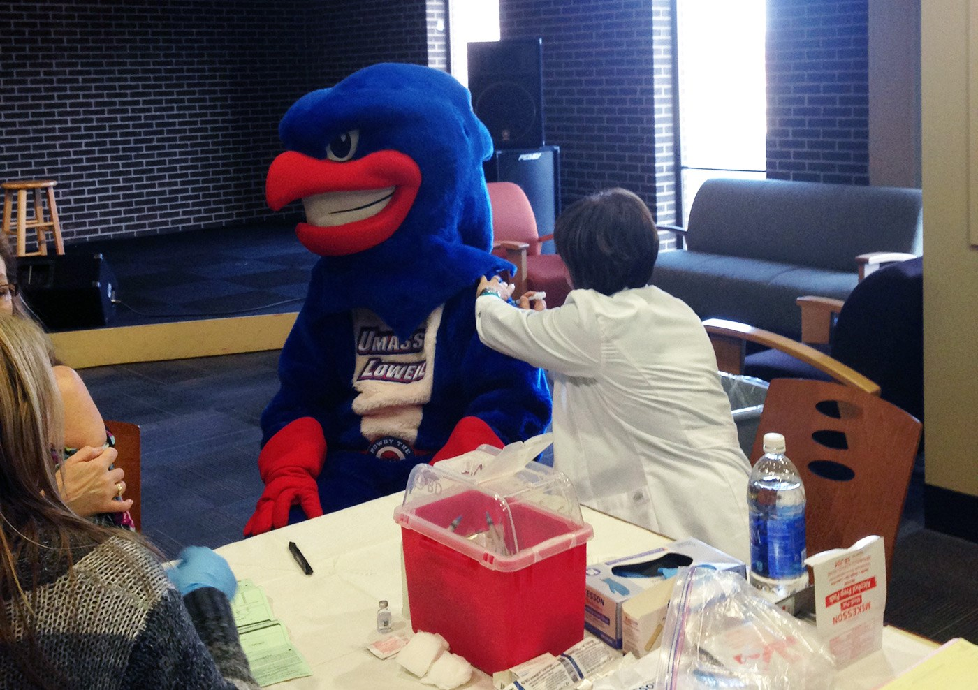 Rowdy getting a flu shot.