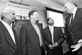 Desh Deshpande, far left, meets with local leaders at a Merrimack Valley Sandbox event yesterday. From left are Deshpande, Sandbox Executive Director Todd Fry, Director of Innovation and Entrepreneurship Nish Acharya, and keynote speaker and president of Harrow College, Tony Medhurst.
