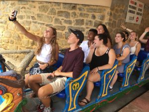 Students take a selfie on a small roller coaster on the top of Monte Igueldo in San Sebastián, Spain
