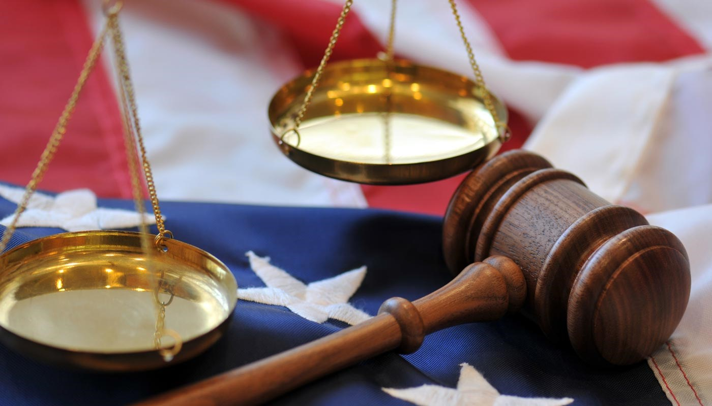 Scales of justice, gavel and American flag