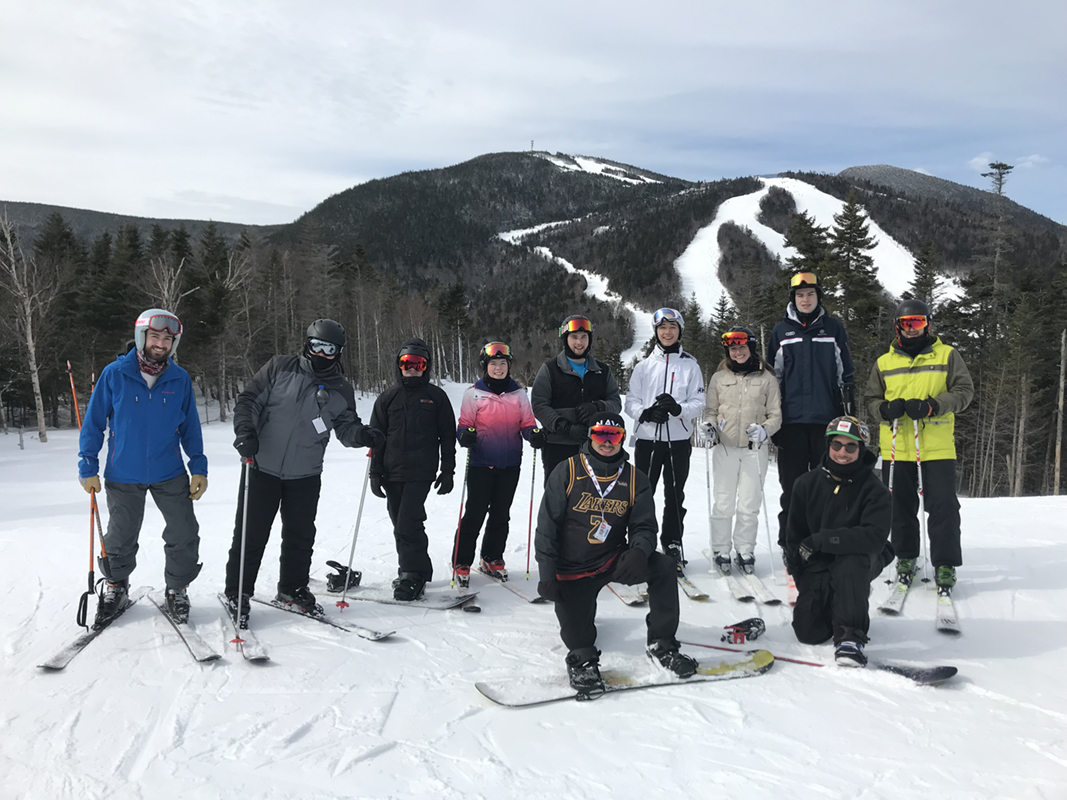 UMass Lowell's Ski and Snowboard Club poses together on the slopes