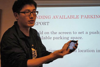 "Peng Xia explains the ""UML Parking Finder"" smartphone app he developed in collaboration with fellow student Shan Lu."