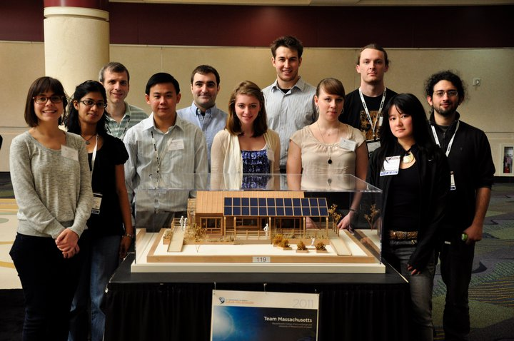 Members of Team Massachusetts from UMass Lowell, from left, Kemmeng Peng, a master's candidate in mechanical engineering; Matthew Polese, an undergraduate senior in management major; Raam Perumal, Apurav Jain and Srilakshmi Kurmana, all master's candidates in energy engineering, pose with a scale model of the energy-efficient house the team is entering at this year's Solar Decathlon. The competition is from Sept. 23 to Oct. 2 in Washington, D.C.  Photo Courtesy/Team Massachusetts