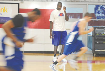 UMass Lowell assistant basketball coach Souleymane Wane, who played for national champion UConn in 1999, watches players go through their paces at a River Hawk practice this week.