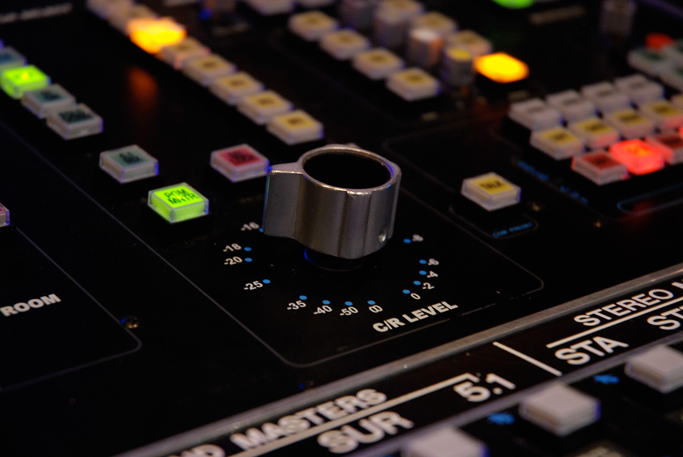 A close up of a knob on a soundboard in a studio of the Sound Recording Technology program.