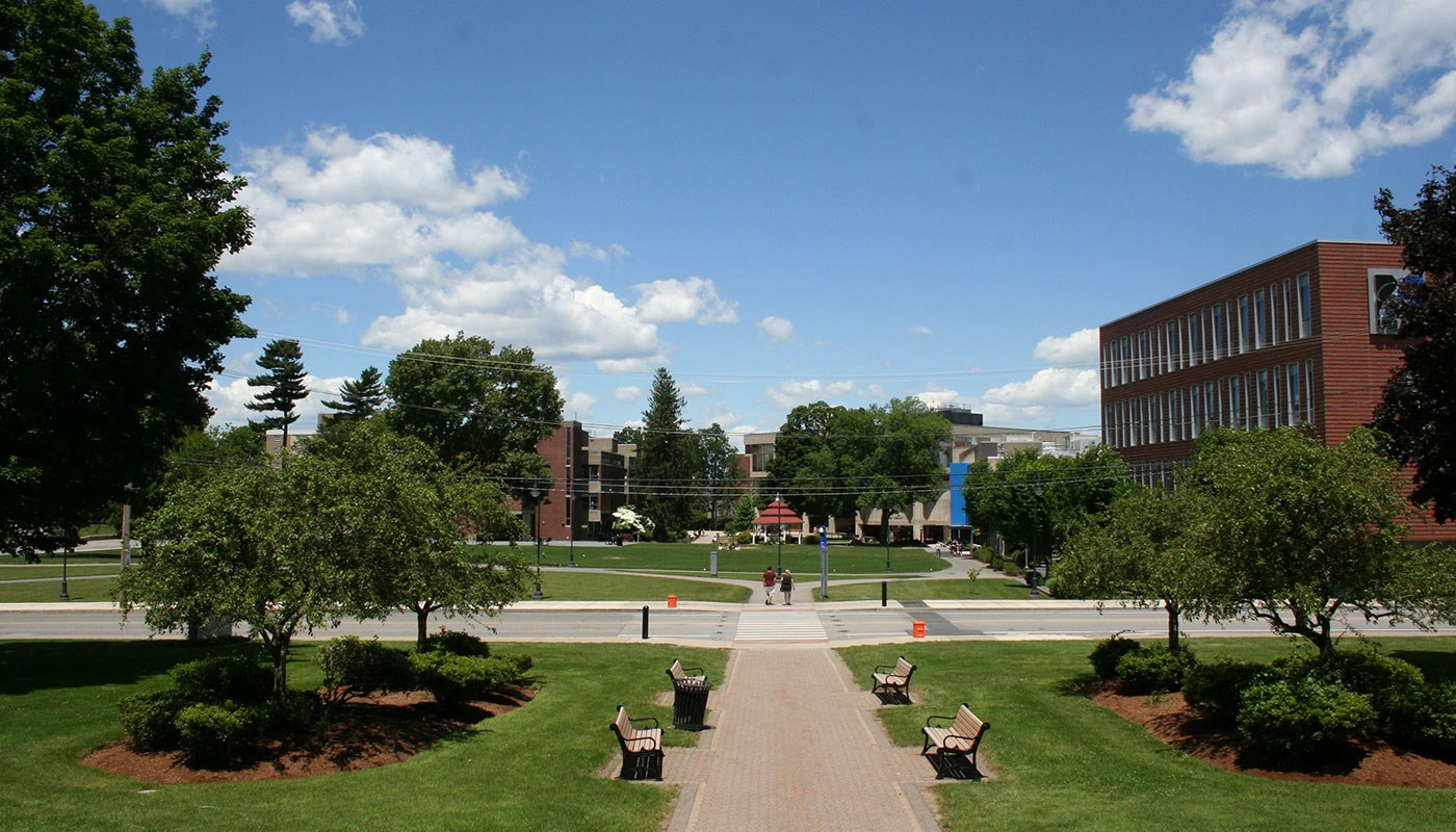 Wide shot of UML South Campus quad with gazebo in distance in center