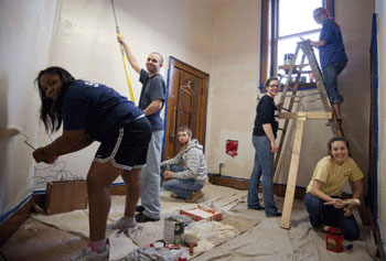 Members of UMass Lowell's Alternative Spring Break Club do some painting at the historic Pawtucket Congregational Church as part of the Lowell Immersion community service project.