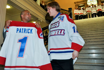 Junior Josh Holmstrom presents Gov. Deval Patrick with a UMass Lowell home jersey. Bob Ellis photo