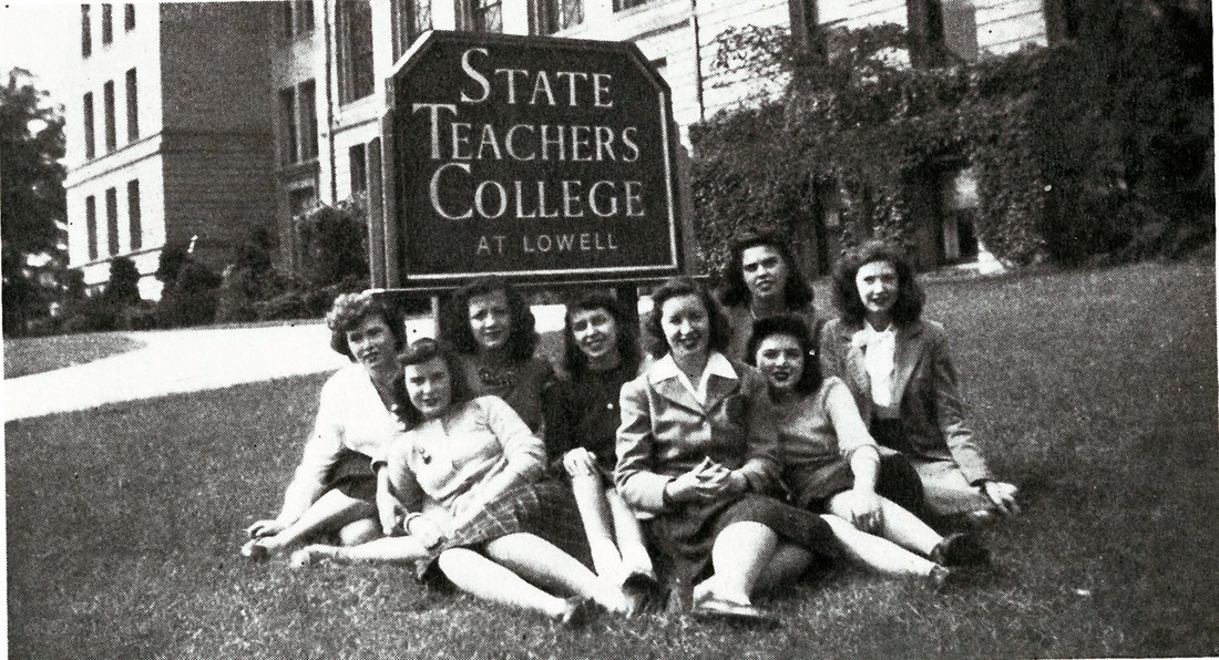 Female students pose for a photo in front of the State Teachers College at Lowell sign in 1946