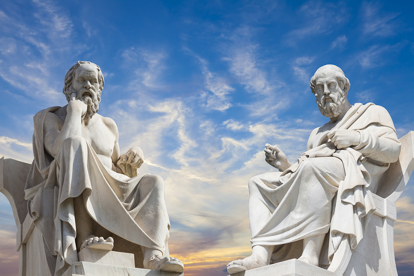 A stock image of two statues of Plato and Socrates - the great ancient Greek philosophers.