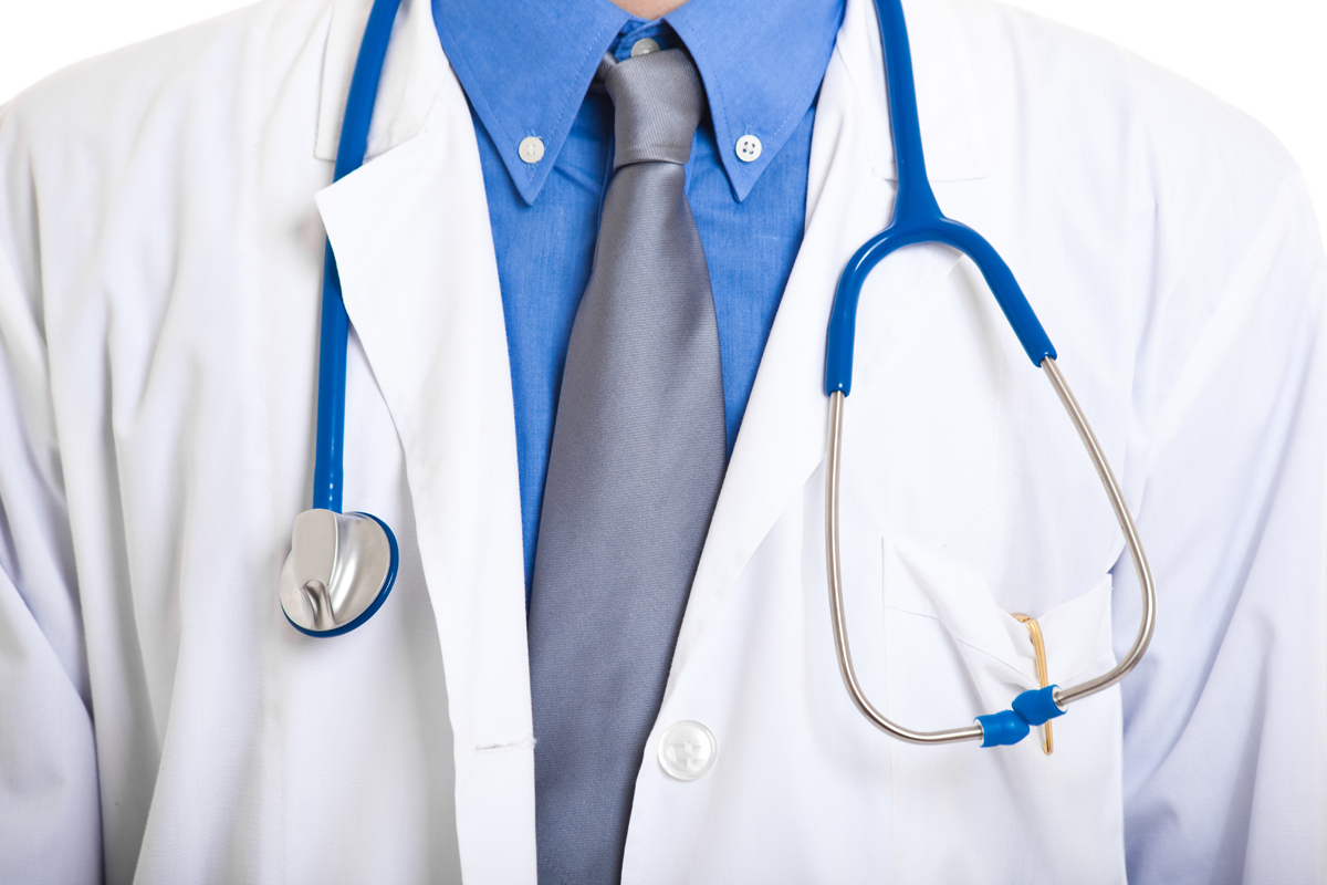 Closeup of stethoscope around a male doctor's neck