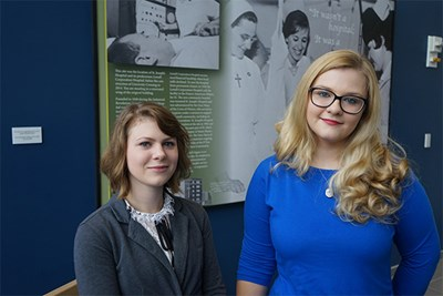 Kim Cosgrove (left) and Kady Phelps created an exhibit about the history of St. Joseph's Hospital