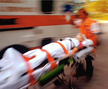 Blurred image of a person on a stretcher.