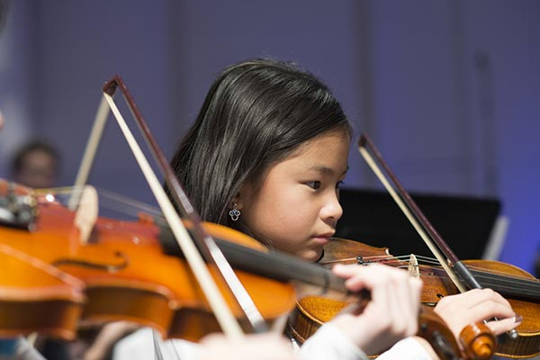 A student in UMass Lowell's String Project.