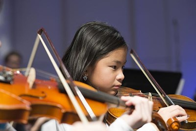 Strings Project student plays violin.