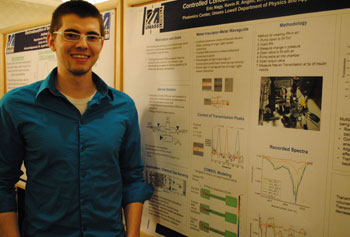 Physics student Eric Nagy shows his research on the detection of lower levels of chemical gases for military applications.