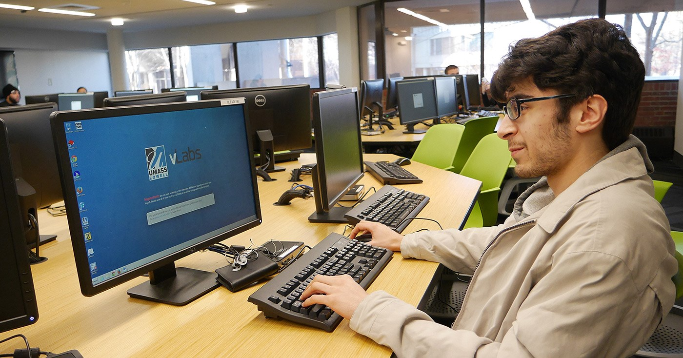 A student using vLabs on a computer at the O'Leary Library.