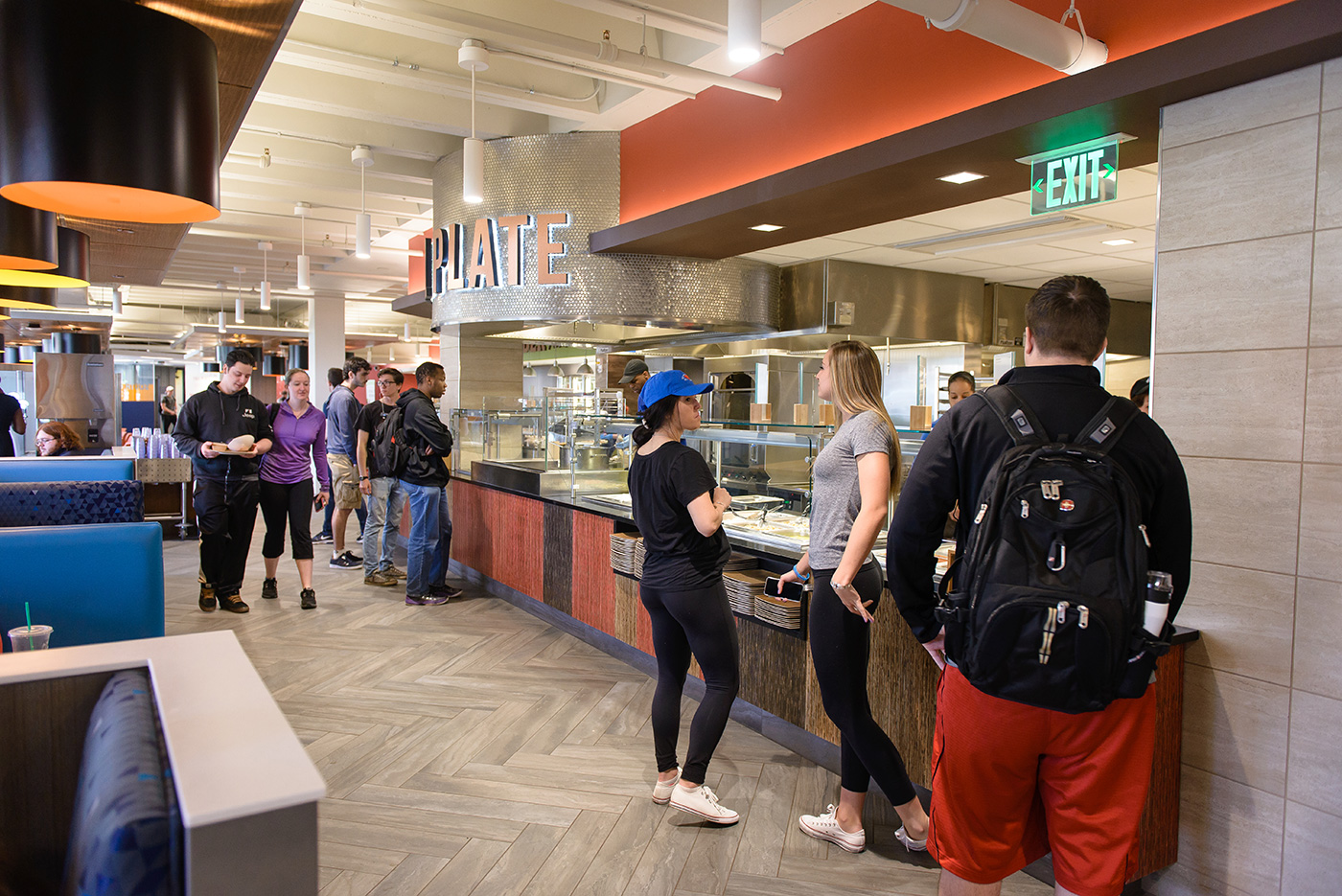 Students eating, getting food and talking at the South Campus Dining Commons in the McGauvran Center.