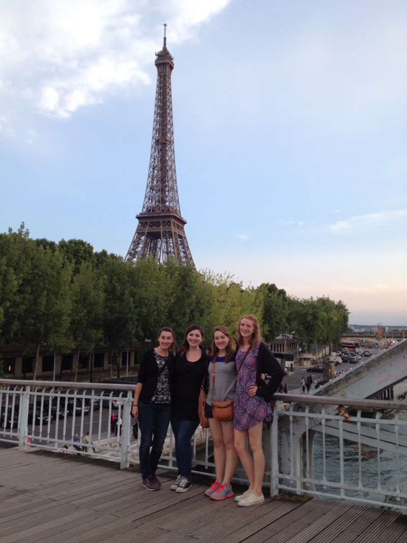UMass Lowell study abroad students pose in front of the Eiffel Tower in Paris, France.