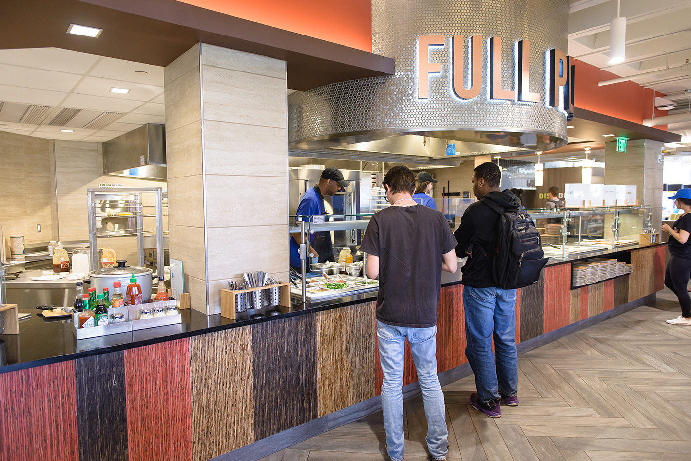 The South Campus Dining Commons, located in the center of campus, features nine different cooking stations including an omelet bar, a waffle bar and an exhibition station where students can create their own culinary masterpieces.
