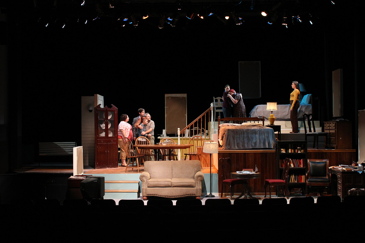 Students performing on stage during a UMass Lowell Theatre Arts production.