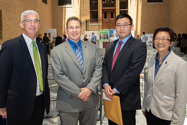 From left are Tim Cunniff of Little Leaf Farms, with UMass Lowell Provost Michael Vayda, assistant professor Boce Zhang and Vice Chancellor of Research Julie Chen.