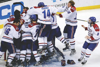UMass Lowell players celebrate their 1-0 Hockey East win over Boston University at the TD Garden.