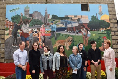 People stand in front of new mural
