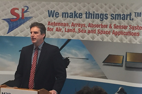 Massachusetts Housing and Economic Development Secretary Jay Ash announced a $400,000 grant for UMass Lowell and SI2 Technologies on Thursday at the Billerica facility of SI2 Technologies.