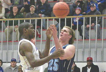 UMass Lowell's Antonio Bivins, left, and Maine's Till Gloger seemed mesmerized by the ball during action Thursday night in Lowell. UML won, 84-72.