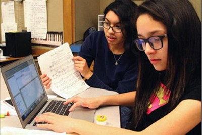 UMass Lowell student Mirza Gracia, 23, and Hazel Rivera, 11, a Bartlett sixth-grader