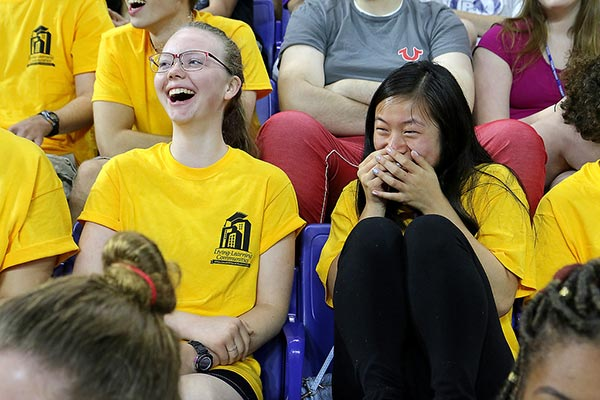 UMass Lowell freshmen Ania Burgess, left, of Newbury and Lily Green of Brockton had a good laugh listening to convocation keynote speaker Cory Ciocchetti.